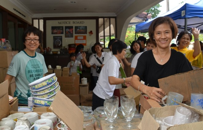 "Over at Nalanda House today (Sunday, 24 July), volunteers help to sort out items to be sold during ""Family Fun Fair""."