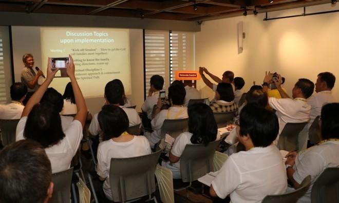 "Sis. Paruadi doing a presentation on Nalanda's ""Dhamma Family"" initiative."