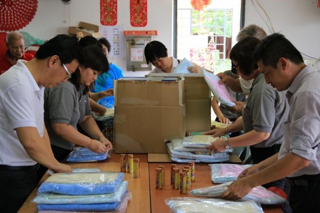 Packing towels at Tong Sim home.