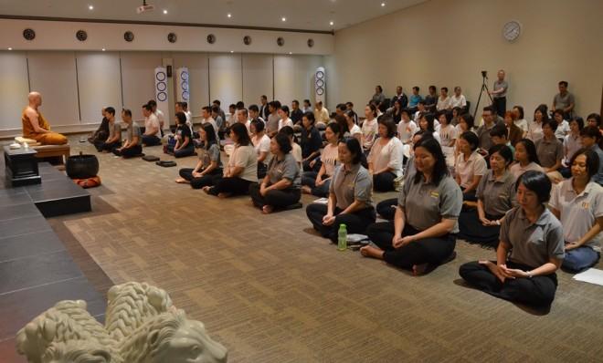 Ajahn leading the meditation session.