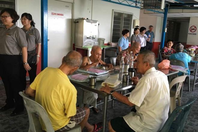 Inmates at Ci Hang Chempaka home enjoying a tea-break.