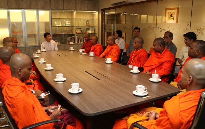 Bro. Tan briefing the venerables on educational programmes organised by Nalanda Society, Institute, and Dhamma School.
