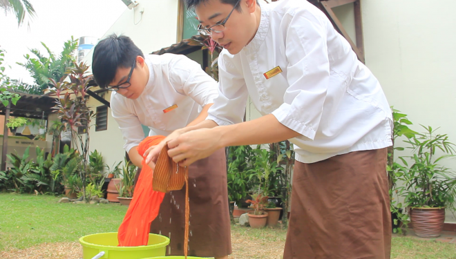 Facilitators and students took turns to participate in the robe washing.