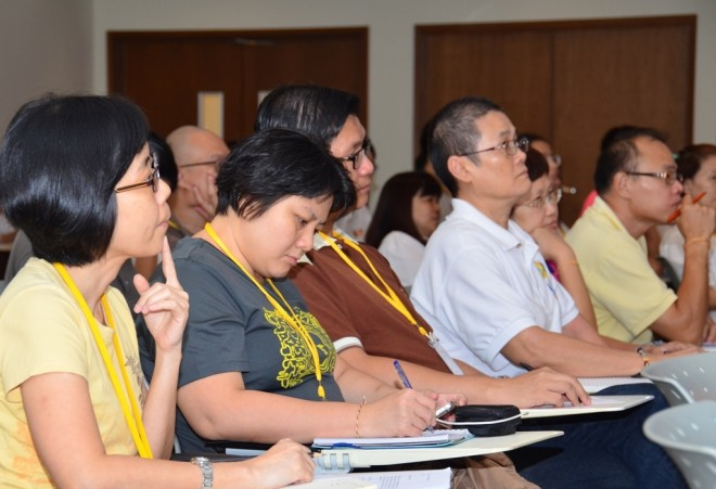Participants listening attentively to the lecture.
