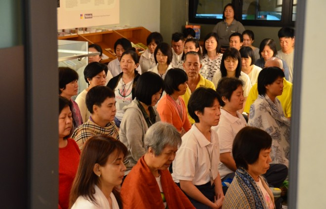Participants sitting quietly and establishing their mindful attention on breathing.