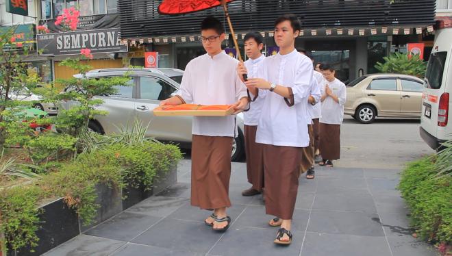 Student captains led the short walk from Nalanda Centre to Nalanda House opposite the road.