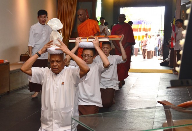 The three exemplary Nalandians were given the honour of conveying the objects of veneration.