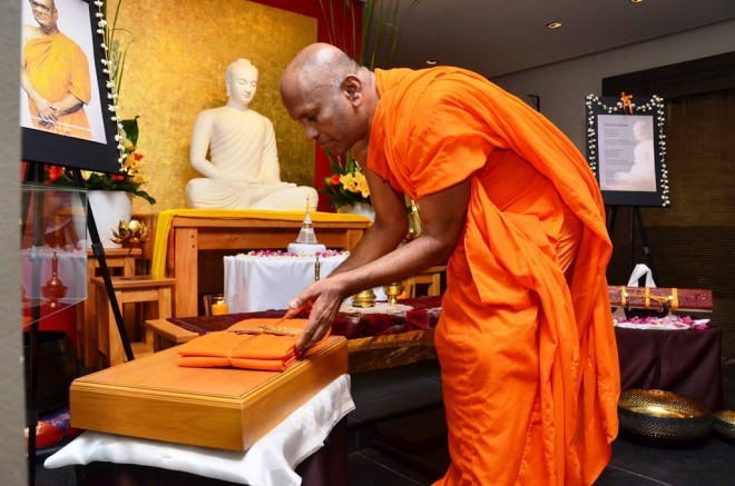 The robe of the late Ven. K. Sri Dhammananda was also laid at its place.