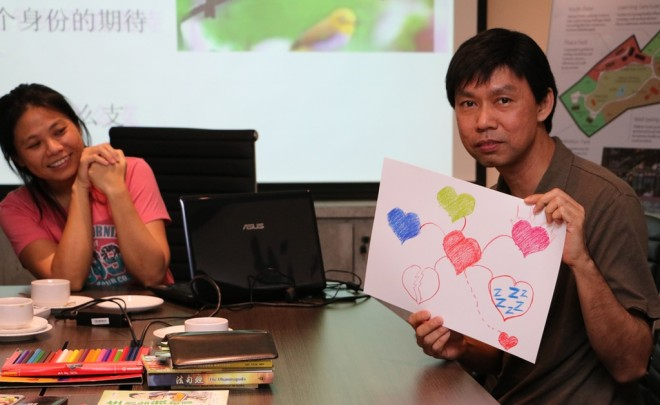 Sis. Ta Lin (left) conducting an activity with Free School volunteer teachers.