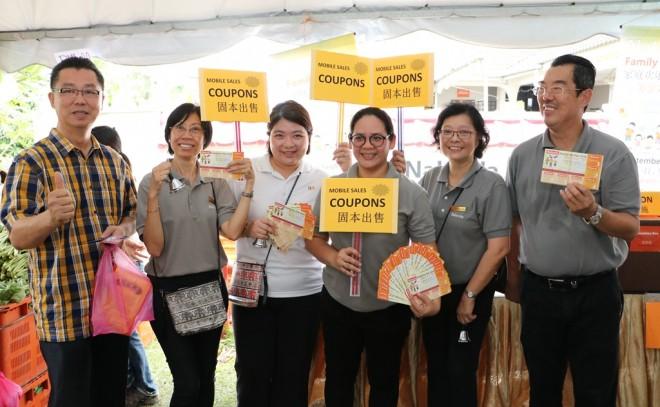 Energetic coupon sales volunteers.