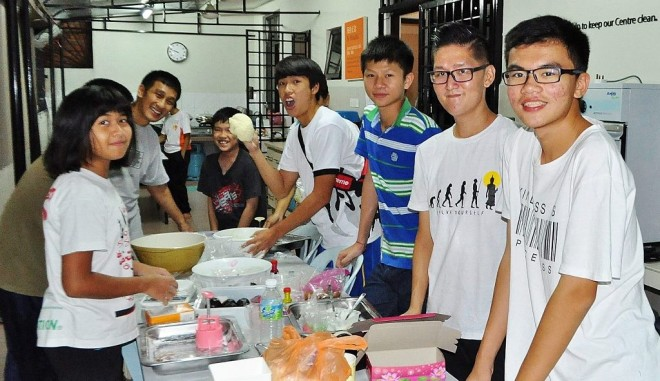 Dhamma School students making mooncakes.