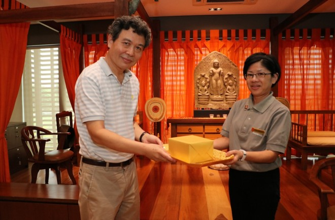 Presenting a gift to Bro. Benny Liow.