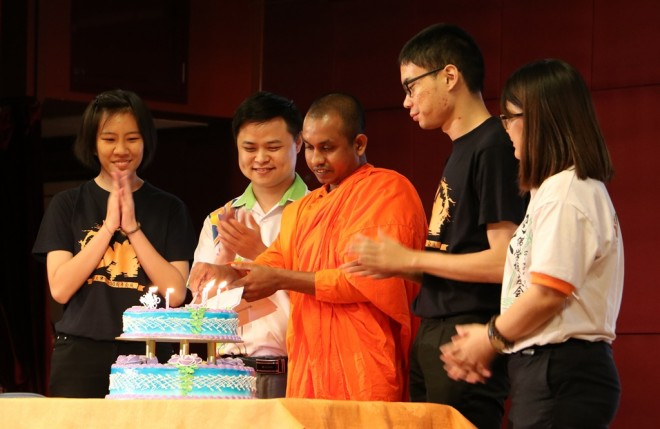 Venerable Rahula cutting a special cake to mark the golden anniversary of the society.