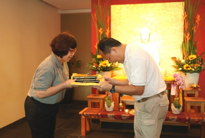 """Sis. Evelyn presenting copies of  """"Without & Within"""" to Dr. Ng."""