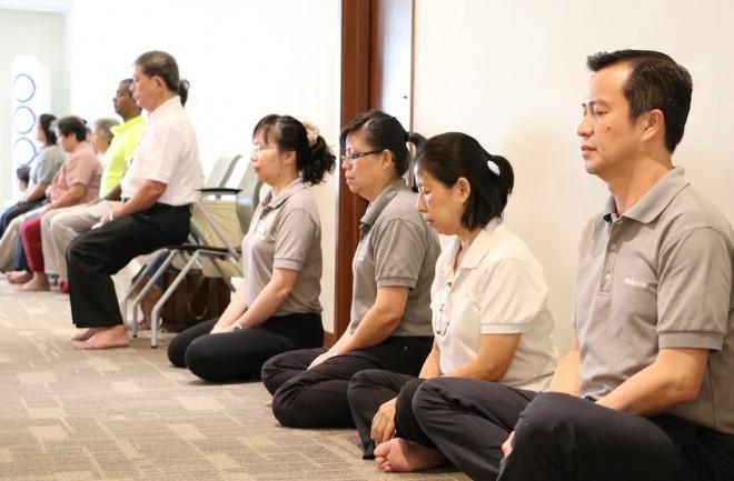 Nalandians starting Sunday Service with meditation.