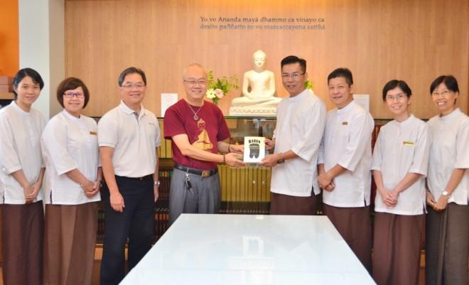 Dr. Wong presenting his book to Nalanda Library