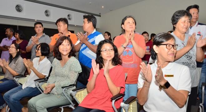 Parents and students giving Nalanda Free School teachers a standing ovation.