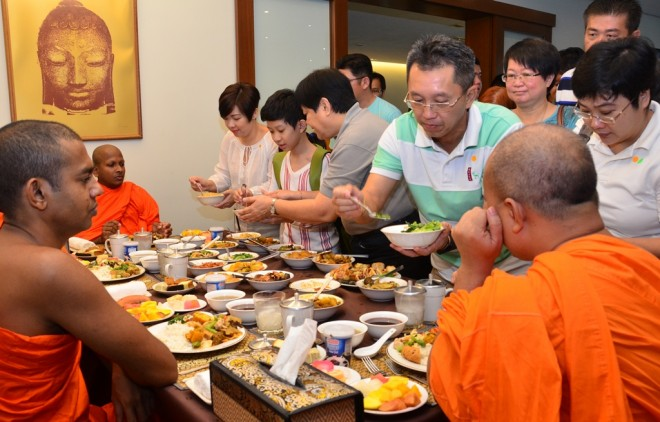 Devotees also get the opportunity to offer food to venerable monks.