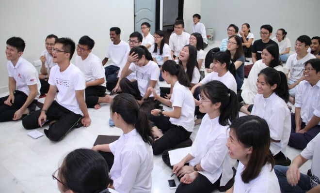 Laughter ringing throughout the Youth Centre during Bro. Tan's teaching.