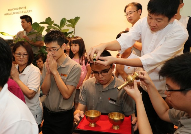Bro. Tan representing the congregation in dedicating merits to the world.