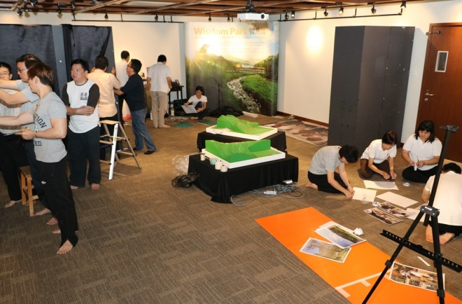 Volunteers working late on Wednesday night to set up the exhibition.