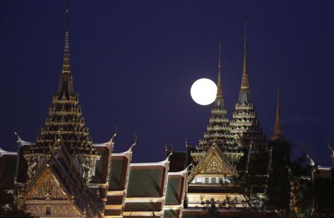 'Supermoon' rising over the Grand Palace in Bangkok.