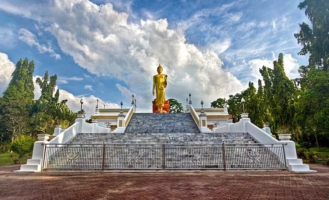 Standing Buddha image at Wat Phikulthong Vararam.