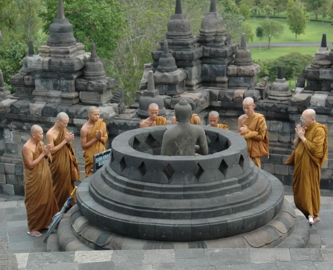 Monks praying at Borobudur.