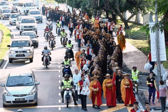 The disciplined procession of Sangha members through the streets of George Town, Penang.