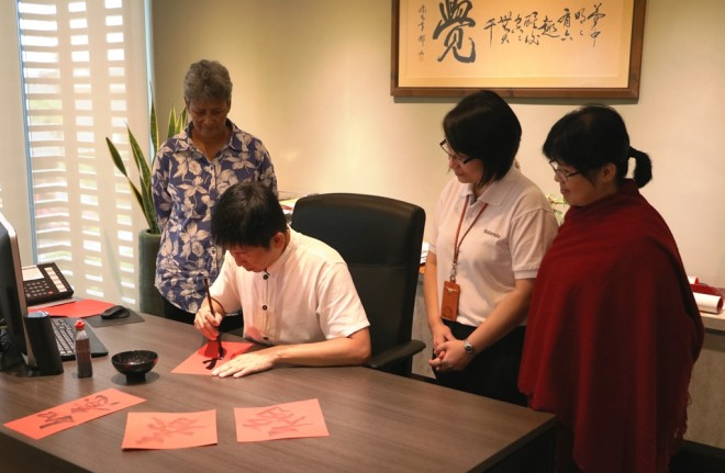 Bro. Tan writing calligraphy for officers this New Year.