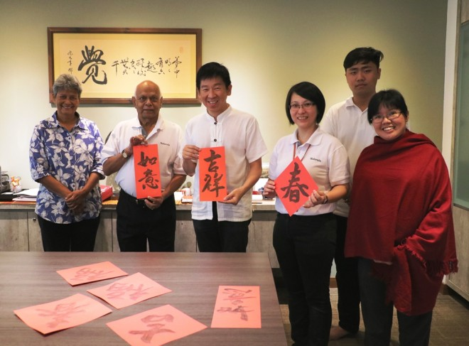 Nalandians gather at the EXCO Room for the writing of New Year calligraphy.