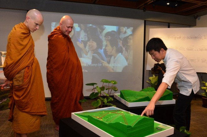 Bro. Tan briefing Ajahn Kalyāno and Ven. Kovido about the Wisdom Park project.