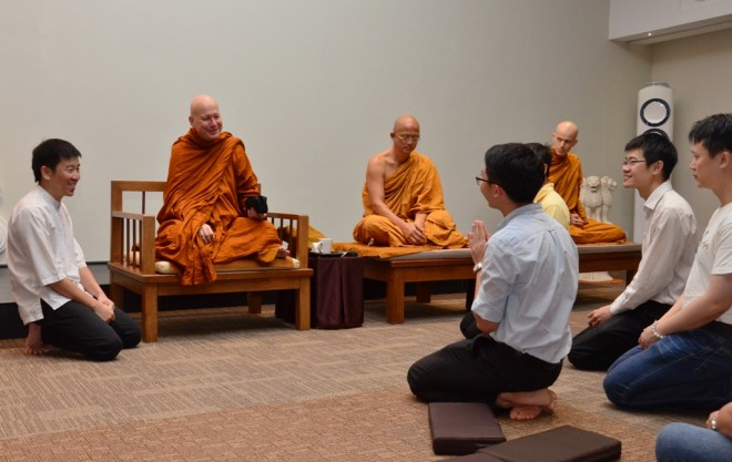Ajahn meeting with young Nalandians and encouraging everyone to practise Dhamma.