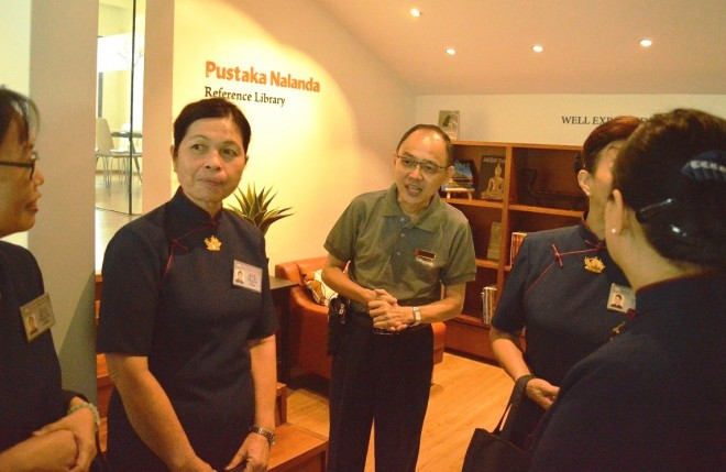 Deputy Branch Chairman Dr. Song hosting the visitors on a building tour.