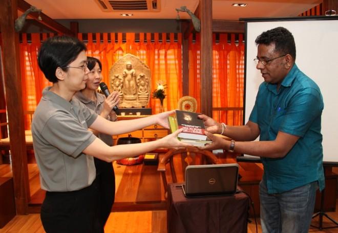 Dr. Shantha Abeysinghe from Sri Lanka, donating some publications to Nalanda Library.