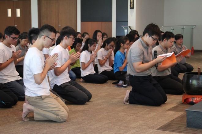 Participants observe meditation and chanting.