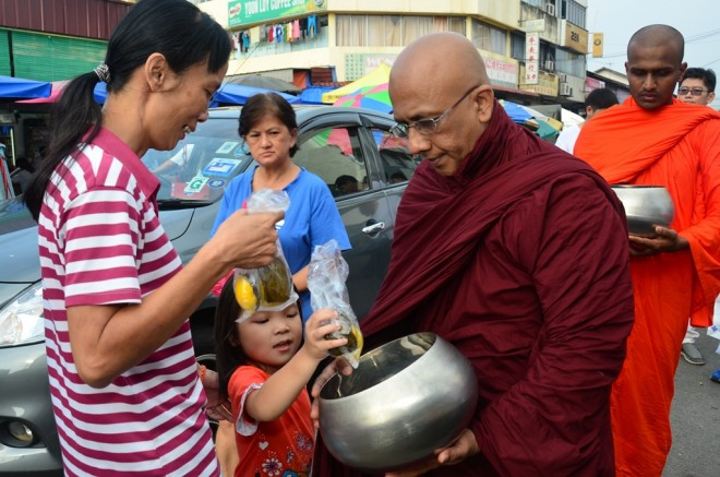 The monthly alms-round has been warmly received by the local community.