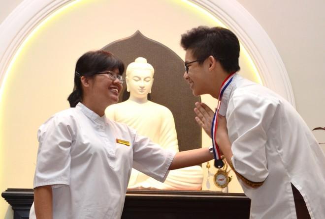 School Director Sis. Sunanda congratulating Garuda House Captain Neville Lee.