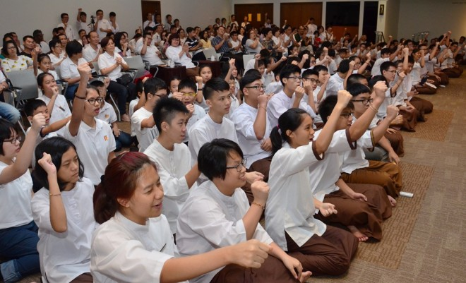 Students cheering for their friends who receive various awards.