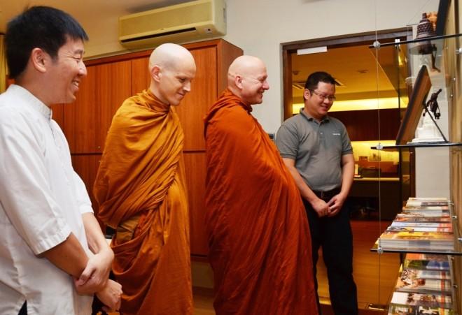 Host-officer Bro. Tong leading a tour of Nalanda Centre.