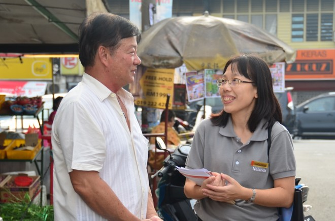 Nalandian volunteers engaging with market-goers.