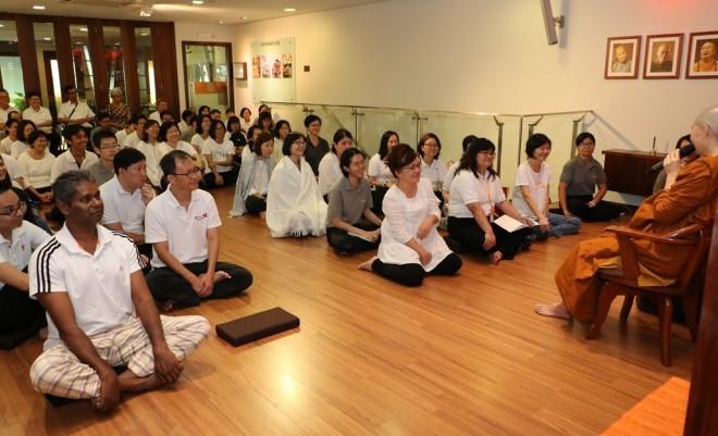 Ayya Sumangalā giving a Dhamma talk on 'welcoming happiness'.