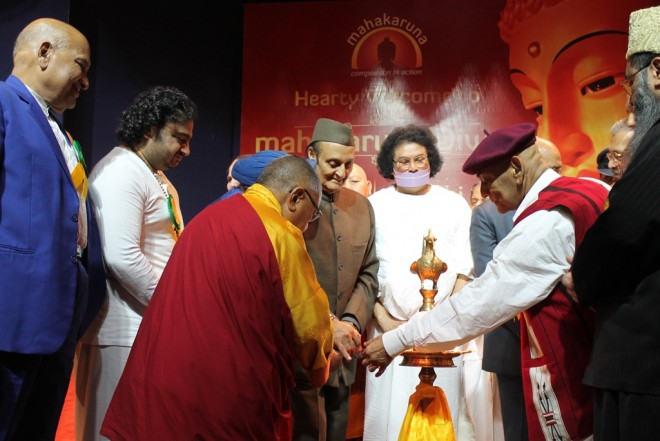 Leaders of multi-faiths lighting a ceremonial lamp to inaugurate the gathering.