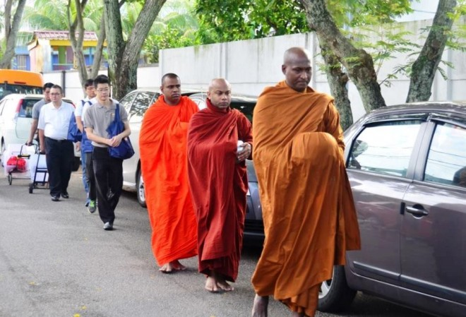 The venerable monks walking to the market followed by a line of volunteer helpers.