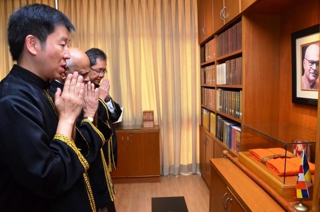 Bro. Tan leading 'dedication of merits'.