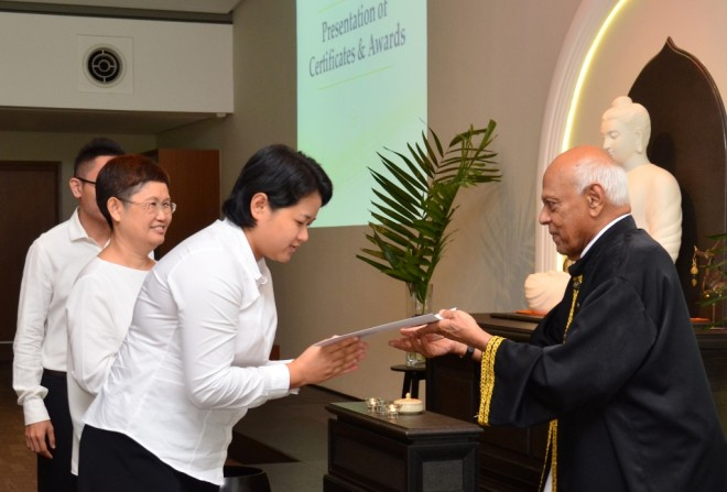 Achariya Vijaya presenting certificates to graduates.