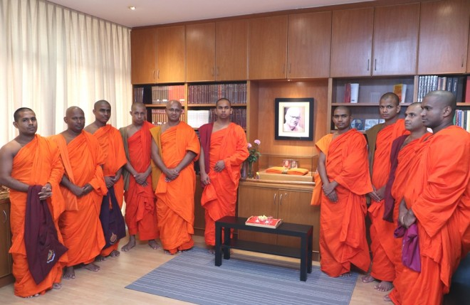 Paying respect at the K. Sri Dhammananda Shrine in Sumangala Room at Nalanda Library.