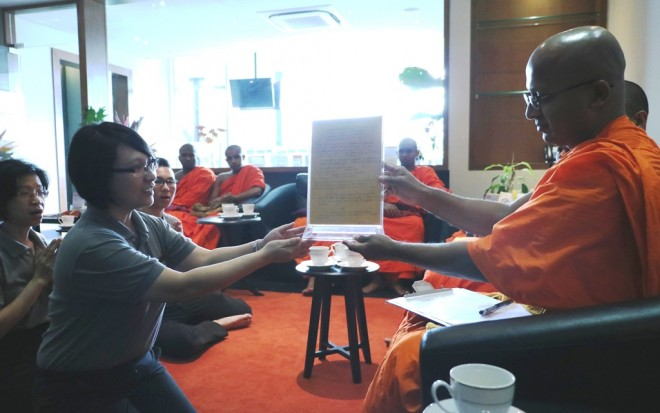 Presenting the monks' message to Nalanda and Bro Tan.