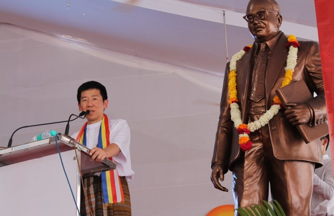 Bro. Tan speaking under the shadow of Dr. Babasaheb Ambedkar.