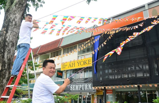 Decking the building with Buddhist flags.